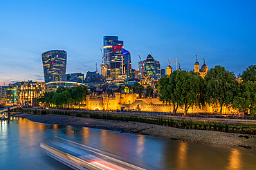 The London City Skyline with the Tower of London at sunset, London