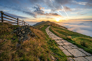 Flagged path leading to Losehill and Great Ridge with rolling mist in Edale Valley, Derbyshire