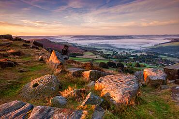 Low lying cloud filling valley below Curbar Edge, Peak District, Derbyshire