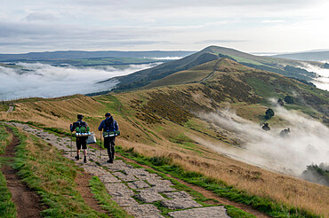 Walkers on The Great Ridge with cloud inversion, Edale, The Peak District, Derbyshire