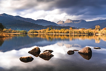 The Langdale Pikes reflected in the tranquil River Brathay, autumn, Elterwater, Lake District National Park, UNESCO World Heritage Site, Cumbria, England, United Kingdom, Europe