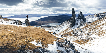 Hiker admiring view towards the Old Man of Storr, near Portree, Isle of Skye, Inner Hebrides, Highland, Scotland, United Kingdom, Europe