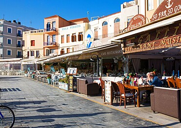 Colourful waterfront cafes and hotels beside the Venetian Harbour, Hania (Chania), Crete, Greek Islands, Greece, Europe