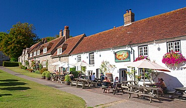 The 16th century Tiger Inn beside the village green, East Dean, South Downs National Park, East Sussex, England, United Kingdom, Europe
