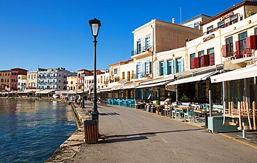 Colourful waterfront cafes beside the Venetian Harbour, Hania (Chania), Crete, Greek Islands, Greece, Europe