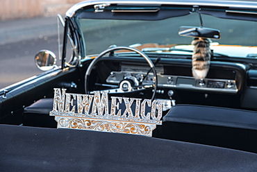 Detail of a shiny New Mexico sign affixed to a vintage car, in Old town, Albuquerque, New Mexico, United States of America, North America