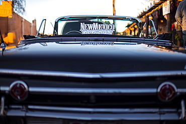Detail of a vintage car with a New Mexico sign on it, in Old town, Albuquerque, New Mexico, United States of America, North America