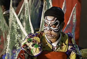 An actor waiting backstage before a performance of Vietnamese opera (hat boi), Vietnam, Indochina, Southeast Asia, Asia