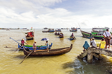 Sampans and other small boats in Sittwe harbour, with people standing on the shore, Rakhine, Myanmar (Burma), Asia