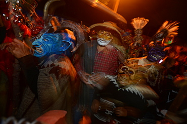 Comparsas (street dances) at the village of Yahuche where people disguise as mythical creatures, Oaxaca, Mexico, North America