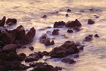 Sea breaking against rocks on the coast at Coverack, Cornwall, England, United Kingdom, Europe