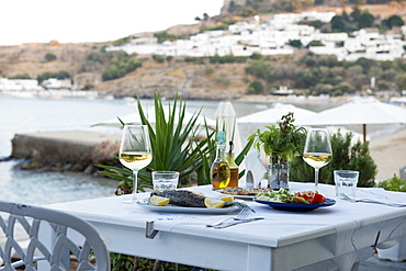 Fish and salad served at a Greek restaurant by the sea, Lindos, Rhodes, Dodecanese, Greek Islands, Greece, Europe
