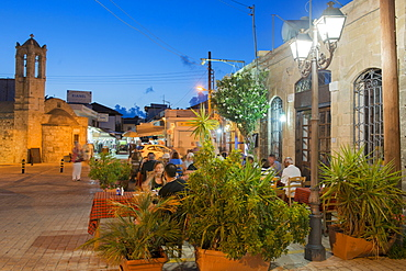 People eating at a restaurant outdoors at night in Latchi, Cyprus, Mediterranean, Europe - 1331-83