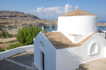 Church overlooking Lindos Beach, Lindos, Rhodes, Dodecanese, Greek Islands, Greece, Europe