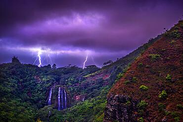 Lightning flashes behind Opekaa Falls, Kauai, Hawaii, United States of America, Pacific