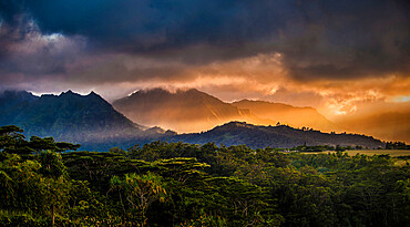 Sunset light streaking through mountains. Kauai, Hawaii