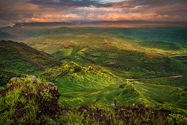 Sunrise over the green southern end of Waimea Canyon in the spring. Kauai, Hawaii