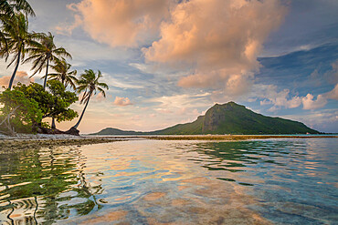 A calm evening in the lagoon of Bora Bora as a cloud forms on top of the mountain.