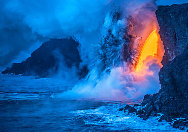 A Lava fall pours from a lava tube 60 feet high. The heat and pressure of super heated ocean steam creates powerful explosions.