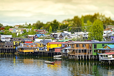 The colorful houses on the water, known as palafitos, in the town of Castro, Island of Chiloé, Chile