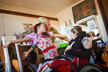 Two clowns from the Hopiclowns association, perform in a home for disabled adults in Geneva, Switzerland.