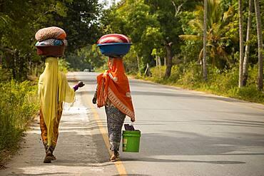Women on a road in Zanzibar.