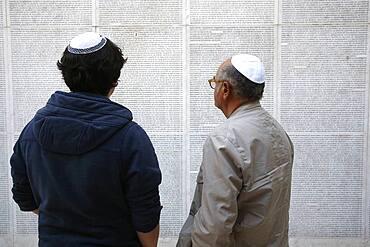 Wall of names at the Paris Holocaust memorial.