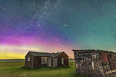 A dim aurora to the north at Grasslands National Park, Saskatchewan, at the Larson Ranch site and its rustic pioneer cabins. Taken August 8, 2016. This is looking northeast to Andromeda (the Andromeda Galaxy is above centre) and Perseus (the Double Cluster is left of centre). This Park is a Dark Sky Preserve. There are no lights visible. Illumination here is from starlight and the setting waxing crescent Moon to the southwest.