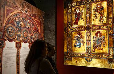 Visitors and Reproductions of pages from the Book of Kells, inThe Old Library, in Trinity College, Dublin, Ireland