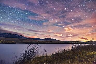 The Big Dipper in hazy clouds over the Waterton River at Maskinonge Pond, September 23, 2016, taken at the Night Photography Workshop I conducted there that night. The glow at right is light pollution from the Shell Waterton Gas Plant and from Pincher Creek to the north.
