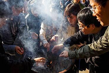 People burning incense, in Kiyomizu-dera temple, Kyoto. Kansai, Japan.