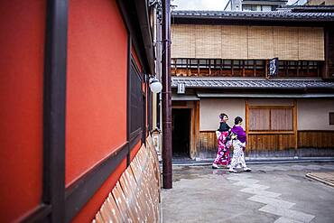Girls dressed in kimono,in Pontocho, a traditional Japanese night-time entertainment area. Kyoto. Japan