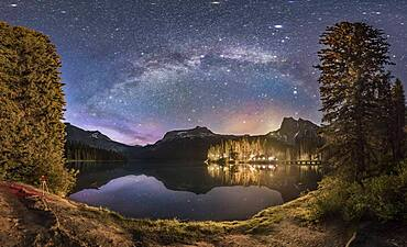 The Milky Way arching over Emerald Lake and Emerald Lake Lodge in Yoho National Park, BC. This was on June 6, 2016 and despite it being about 1:30 am, the sky, especially to the north at left, is still lit by blue twilight from the short solstice night.