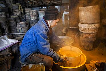 kohei ishimori is sifting sand to make mud, and build a molds to make a iron teapot or tetsubin, nanbu tekki,Workshop of Koizumi family,craftsmen since 1659, Morioka, Iwate Prefecture, Japan
