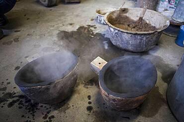 Preparing spoon to load molten iron, that will put in a molds to make a iron teapot or tetsubin, nanbu tekki, Workshop of Koizumi family, Morioka, Iwate Prefecture, Japan