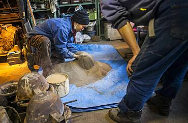 They are checking the quality of the sand to make mud, and build a molds to make a iron teapot or tetsubin, nanbu tekki, Workshop of Koizumi family, Morioka, Iwate Prefecture, Japan