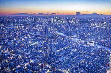 Skyline, Sumidagawa river and in background at right Mount Fuji, Tokyo, Japan