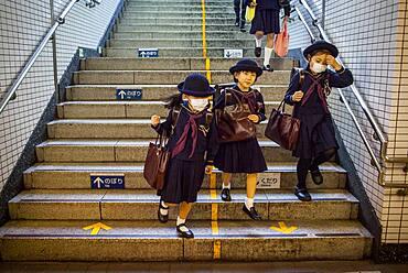 girls, Subway, entrance to Toei Oedo Line, in Roppongi station, Tokyo, Japan.