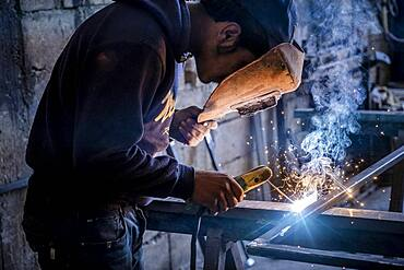Ahmad, 16 years old, works with metals and dangerous machinery, child labour, syrian refugee, in Arsal, Bekaa Valley, Lebanon