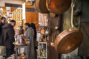 Customers and seller haggling, souk of brass, Place as Seffarine, medina. Fez.Morocco