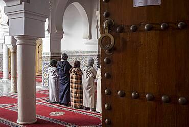 Women praying, Courtyard, Zaouia (tomb) of Moulay Idriss II, medina, Fez. Morocco