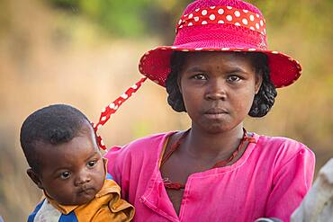 Portrait of Malagasy mother and son, surroundings of Manja village, Madagascar