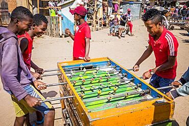 Playing table football, Ambohimahasoa city, Madagascar