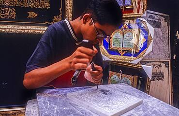 Craftsman making a gravestone, Medina, UNESCO World Heritage Site, Fez, Morocco, Africa.
