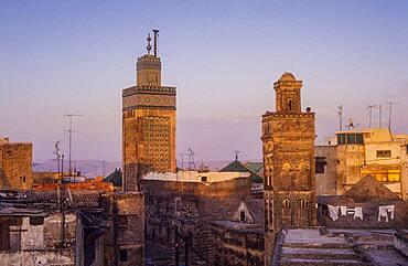 At right minaret of Sidi Lazaze, at left minaret of  Medersa Bou Inania, Medina, UNESCO World Heritage Site, Fez, Morocco, Africa.