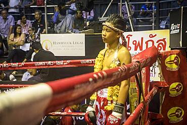Presentation of the fight. Muay Thai fighter going through pre-fight ritual, Bangkok, Thailand