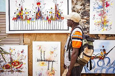 Tourist, in Workshop of Fallow painter, Goree island, near Dakar, Senegal