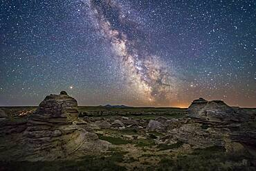 Mars (at left) and the galactic centre area of the summer Milky Way low over the southern horizon at Writing-on-Stone Provincial Park, Alberta, on June 8/9, 2018. Sagittarus is at centre, with Scorpius at right. The Messier 6 and 7 open star clusters are just above the horizon at centre, just right of the Sweetgrass Hills on the horizon in Montana.