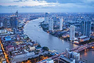 Skyline and Chao phraya River at night, downtown, Bangkok, Thailand