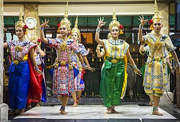Traditional Thai dancers performing for Brahma, they dance on request for donations, Erawan Shrine, Bangkok